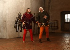 Arguing Men. Two men in Gothic costume arguing as a summer 2015 performance at Svihov Water Castle, Western Bohemia Stock Photo