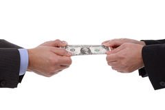 Arguing over money. Currency tug-of-war concept for business rivalry, relationship difficulties or divorce settlement between a man and woman Stock Photography