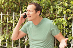 Arguing on the phone Royalty Free Stock Photography