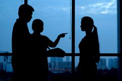 Arguing. Silhouettes of parents arguing with their teenage daughter Stock Photography