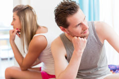 Arguing young couple, man is huffy and remains silent Stock Photo