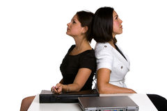 Argument. Two businesswomen is sitting back to back in an argument in the office Royalty Free Stock Photos