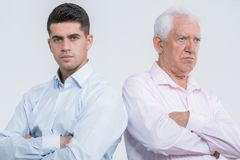Argument between son and father. Argument between mature son and senior father Royalty Free Stock Photos