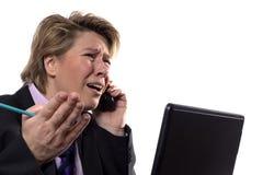 Argumentação da mulher de negócios Fotografia de Stock