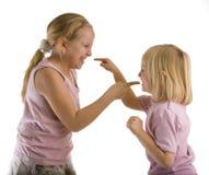Argumentação das irmãs Imagem de Stock