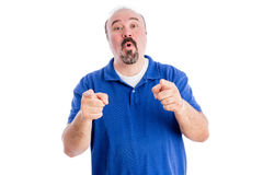 Argumentative loquacious man making a point. Pointing at the camera with his fingers while talking non-stop isolated on white stock photography