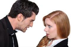 Argumentera för man och för kvinna Arkivfoton