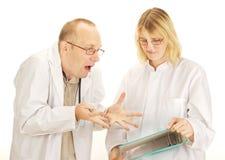 Argumentera för två doktorer Royaltyfri Bild