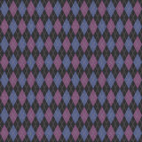 Argyle knit. A seamless tiling pattern made from a knitted Argyle material Royalty Free Stock Photo