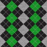 Argyle Pattern. A green and black plaid argyle pattern that tiles seamlessly Royalty Free Stock Photos