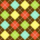 Argyle Pattern. In bright colors on brown background Royalty Free Stock Images