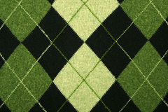 Argyle pattern on a sweater. Argyle pattern in green color tones on a sweater Stock Photos