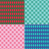 Argyle and snowflake patterns Stock Images