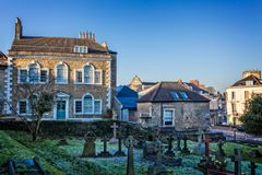 Argyll House and St Johns church cemetery in Frome, Somerset. In winter with frost on the ground Stock Images