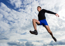 Arhlete in long jump. In track and field Stock Photos