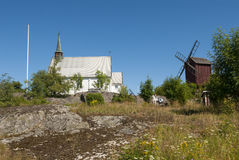 Arholma church and windmill Royalty Free Stock Image