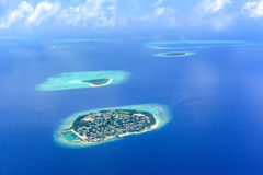 Ari atoll green island Stock Photo