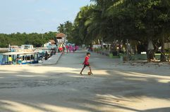 A little boy is playing football in the harbor. Ari Atoll, Maldives - 22 December 2018: A little boy is playing football in the harbor stock photography