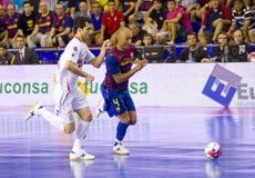 Ari Santos in action. BARCELONA, SPAIN - JUNE 17: Ari Santos (R) of FCB in action at Spanish Futsal League final match between FC Barcelona and El Pozo Murcia Stock Image