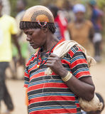 Ari woman in calabash hat/helmet at village market. Bonata. Omo Royalty Free Stock Photos