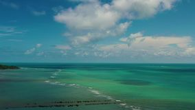 Arial drone flying above the turquoise sea stock footage