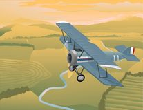 Arial View. Illustration of a bi-plane flying over a rural landscape Royalty Free Stock Photos