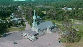 An Arial view of a church on a sunny day stock video footage