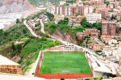 Arial view of the city and football field. People enjoying sports outdoors. Cardona. Spain. Arial view of the city and football field. Cardona. Spain royalty free stock photo
