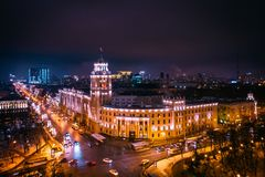 Arial view of famous Voronezh building with tower in night, symbol of Voronezh and evening cityscape with rads, parks and traffic stock images