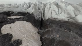 Arial view glaciers on the sleeping Elbrus volcano. The movement of the camera back out of the crack of the glacier with. The opening of the view of the glacier stock footage