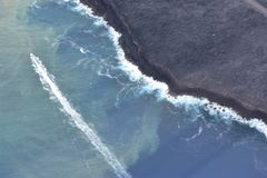 Arial view of Hawaii`s Kilauea volcano pouring into the Pacific Ocean royalty free stock photo