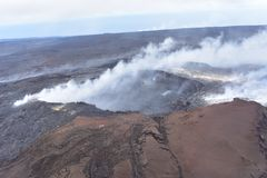 Arial view of Hawaii`s Kilauea volcano with smoke rising stock photos