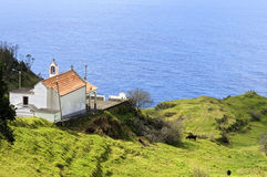 Arial view of Madeira chapel, alp and Atlantic Ocean. Portugal, island Madeira, Cape city Ponta de Pargo, Calheta. Still life of the church, chapel, Nossa Stock Photo