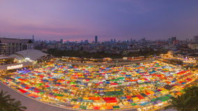 Arial view multiple colours night flea market roof to stock images