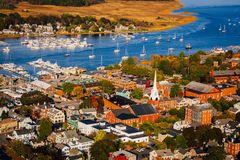 Arial view of a New England town in the Fall. With a church and steeple in the foreground Royalty Free Stock Photos