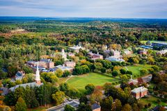Arial view of a Phillips Academy in Andover Massachusetts in the Fall. With a church and steeple in the foreground Royalty Free Stock Image