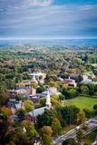 Arial view of a Phillips Academy in Andover Massachusetts in the Fall. With a church and steeple in the foreground Royalty Free Stock Photos