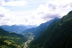 Arial view of road below mountains. Arial view of a road with mountans around.Switzerland Stock Images