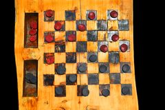 Checkers on a wood log royalty free stock photos