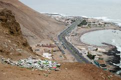 ARICA, CHILE, 2017-01-26: view to the trash in the desert in mountains and highway and beach at the background royalty free stock images