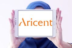 Aricent software company logo. Logo of Aricent software company on samsung tablet holded by arab muslim woman. Aricent is a global software company Royalty Free Stock Photos
