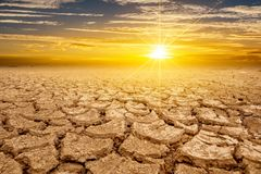 Free Arid Clay Soil Sun Desert Global Worming Concept Cracked Scorched Earth Soil Drought Desert Landscape Dramatic Sunset Royalty Free Stock Photo - 155026625