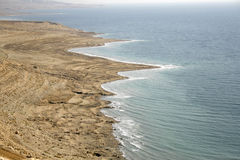 Arid dead sea coastline Royalty Free Stock Photo