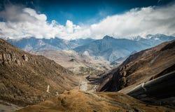 Arid highland wasteland, stone mountain desert. Muktinath region along Annapurna circuit trek Royalty Free Stock Photo