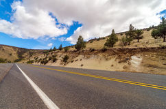 Arid Highway. Highway passing through an arid desert in Central Oregon Royalty Free Stock Image