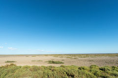 Arid lagoon landscape Stock Photo