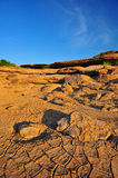 Arid land. Landscape picture of arid land and stone mountain Royalty Free Stock Image