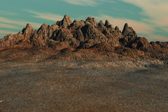 Arid Land. An arid landscape highlighted by a dry mountain formation Royalty Free Stock Images