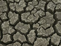 Arid land and cracked ground broken to pieces cause by the sun heat Stock Images
