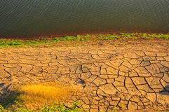 Arid land and lake. Landscape shot of Arid land and lake in thailand Stock Photography